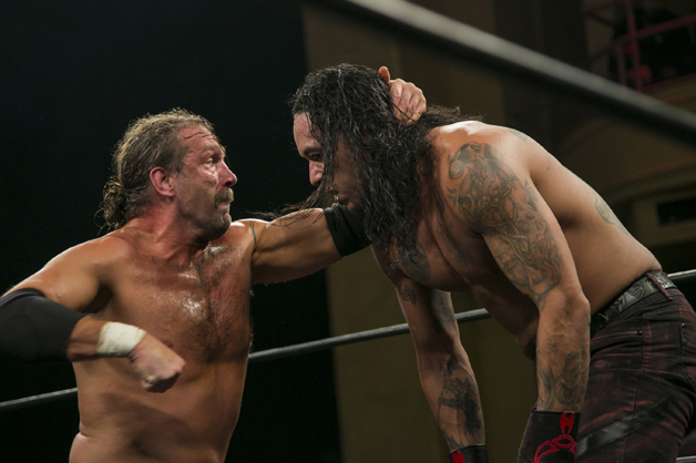 Silas Young Ring Of Honor Wrestling holds belt