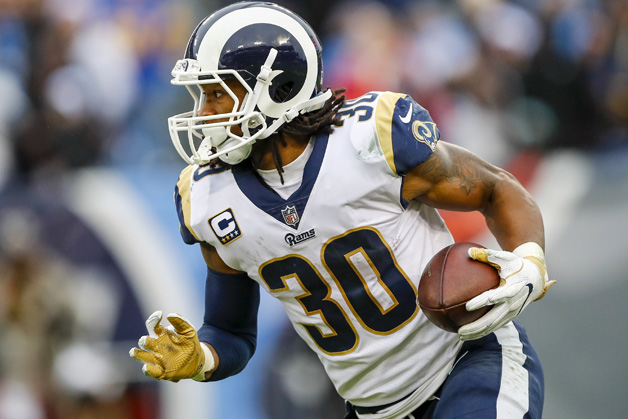Running Back Todd Gurley II #30 of the Los Angeles Rams carries the ball against the Tennessee Titians at Nissan Stadium on December 24, 2017 in Nashville, Tennessee.