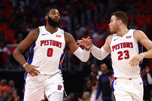 Andre Drummond #0 of the Detroit Pistons celebrates a second half basket with Blake Griffin #23 while playing the Atlanta Hawks at Little Caesars Arena on February 14, 2018 in Detroit, Michigan. Detroit won the game 104-98.