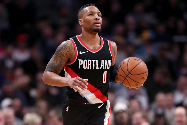 Damian Lillard #0 of the Portland Trail Blazers brings the ball down the court against the Denver Nuggets at the Pepsi Center on January 22, 2018 in Denver, Colorado. NOTE
