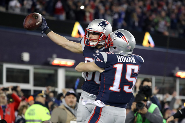 Danny Amendola #80 of the New England Patriotss celebrates with Chris Hogan #15 in the fourth quarter after a touchdown catch during the AFC Championship Game against the Jacksonville Jaguars at Gillette Stadium on January 21, 2018 in Foxborough, Massachusetts.