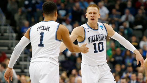 Donte DiVincenzo #10 of the Villanova Wildcats celebrates with his teammate Jalen Brunson #1 against the Alabama Crimson Tide during the second half in the second round of the 2018 NCAA Men's Basketball Tournament at PPG PAINTS Arena on March 17, 2018 in Pittsburgh, Pennsylvania.