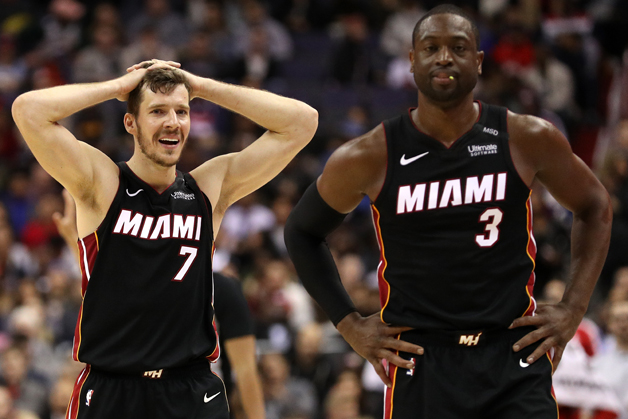 Goran Dragic #7 and Dwyane Wade #3 of the Miami Heat react to a call against the Washington Wizards during the second half at Capital One Arena on March 6, 2018 in Washington, DC.