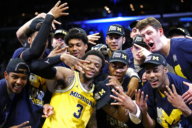 Zavier Simpson #3 and the Michigan Wolverines celebrates after defeating the Florida State Seminoles in the 2018 NCAA Men's Basketball Tournament West Regional Final at Staples Center on March 24, 2018 in Los Angeles, California. The Michigan Wolverines defeated the Florida State Seminoles 58-54.