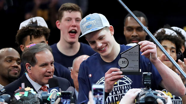 Moritz Wagner #13 of the Michigan Wolverines raises his MVP trophy after defeating the Purdue Boilermakers 75-66 during the championship game of the Big 10 Basketball Tournament at Madison Square Garden on March 4, 2018 in New York City.