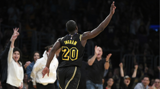 Andre Ingram #20 of the Los Angeles Lakers celebrates after making a three pointer in the second half of the game against the Houston Rockets on April 10, 2018 at STAPLES Center in Los Angeles, California.
