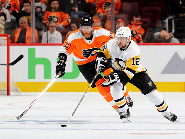 Dominik Simon #12 of the Pittsburgh Penguins takes the puck as Jakub Voracek #93 of the Philadelphia Flyers defends in Game Four of the Eastern Conference First Round during the 2018 NHL Stanley Cup Playoffs at Wells Fargo Center on April 18, 2018 in Philadelphia, Pennsylvania.The Pittsburgh Penguins defeated the Philadelphia Flyers 5-0.