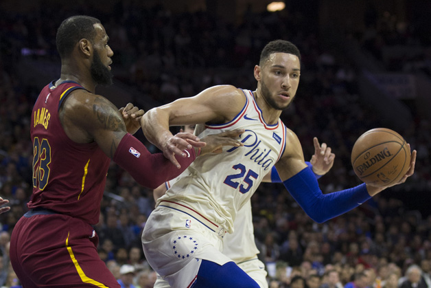 Ben Simmons #25 of the Philadelphia 76ers controls the ball against LeBron James #23 of the Cleveland Cavaliers in the first quarter at the Wells Fargo Center on April 6, 2018 in Philadelphia, Pennsylvania.