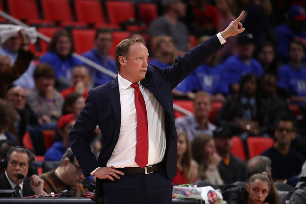 Head coach Mike Budenholzer of the Atlanta Hawks looks on from the bench while playing the Detroit Pistons at Little Caesars Arena on November 10, 2017 in Detroit, Michigan. Detroit won the game 111-104.