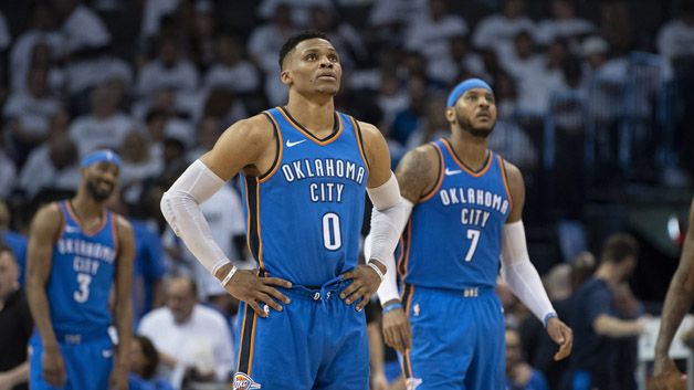 Russell Westbrook #0 of the Oklahoma City Thunder and Carmelo Anthony #7 of the Oklahoma City Thunder watch the game clock during the second half of game 5 of the Western Conference playoffs against the Utah Jazz at the Chesapeake Energy Arena on April 25, 2018 in Oklahoma City, Oklahoma.