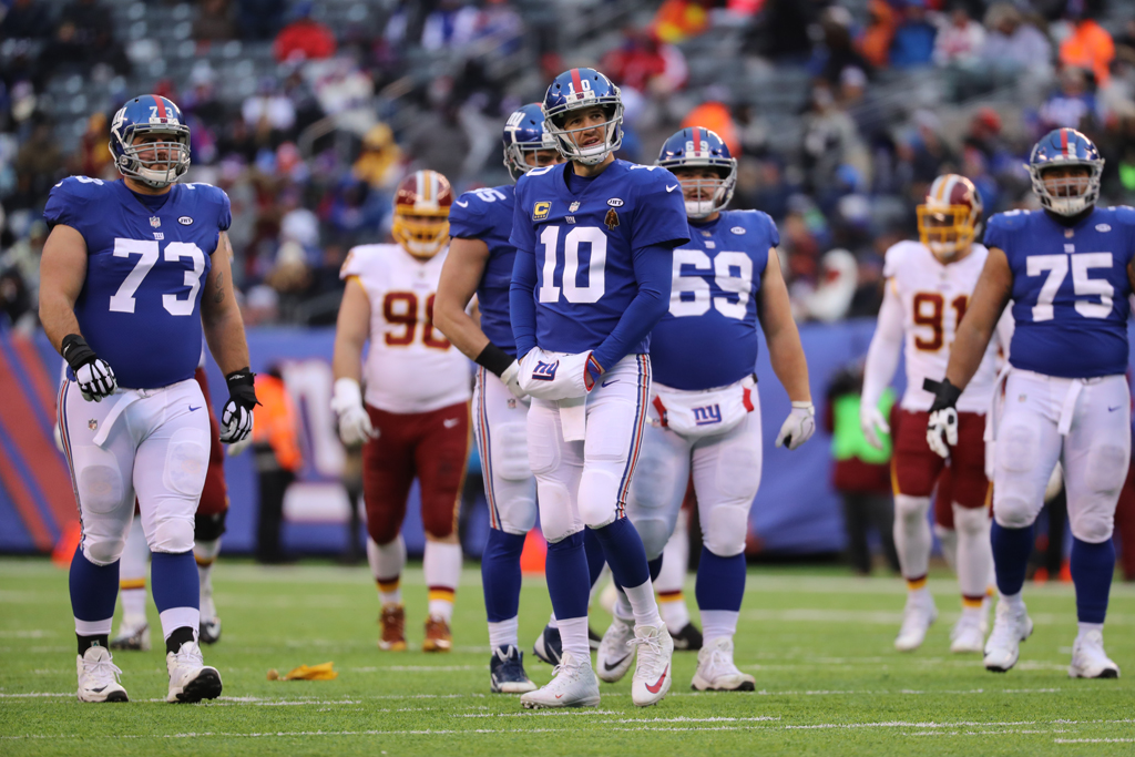 Eli Manning #10 of the New York Giants looks on in the third quarter against the Washington Redskins during their game at MetLife Stadium on December 31, 2017 in East Rutherford, New Jersey.
