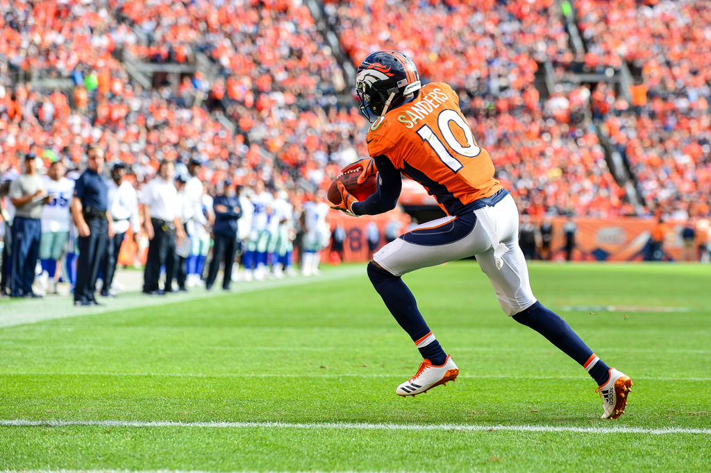 Wide receiver Emmanuel Sanders #10 of the Denver Broncos has a six yard touchdown reception in the second quarter of a game against the Dallas Cowboys at Sports Authority Field at Mile High on September 17, 2017 in Denver, Colorado.