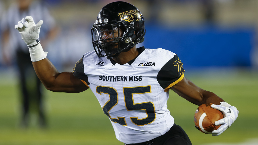 Ito Smith #25 of the Southern Miss Golden Eagles runs the ball against the Kentucky Wildcats at Commonwealth Stadium on September 3, 2016 in Louisville, Kentucky. Southern Mississippi defeated Kentucky 44-35.