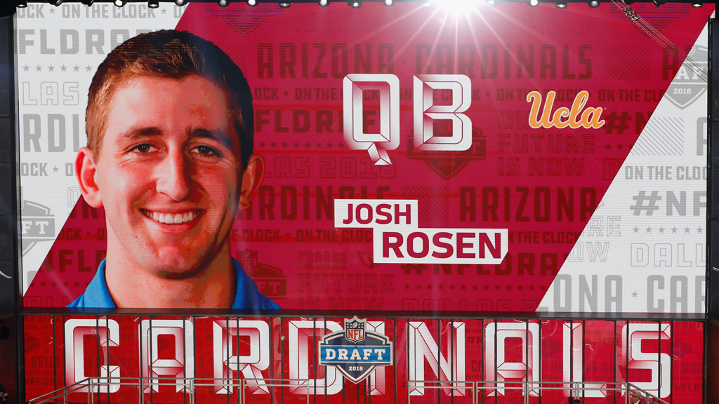 A video board displays an image of Josh Rosen of UCLA after he was picked #10 overall by the Arizona Cardinals during the first round of the 2018 NFL Draft at AT&T Stadium on April 26, 2018 in Arlington, Texas.