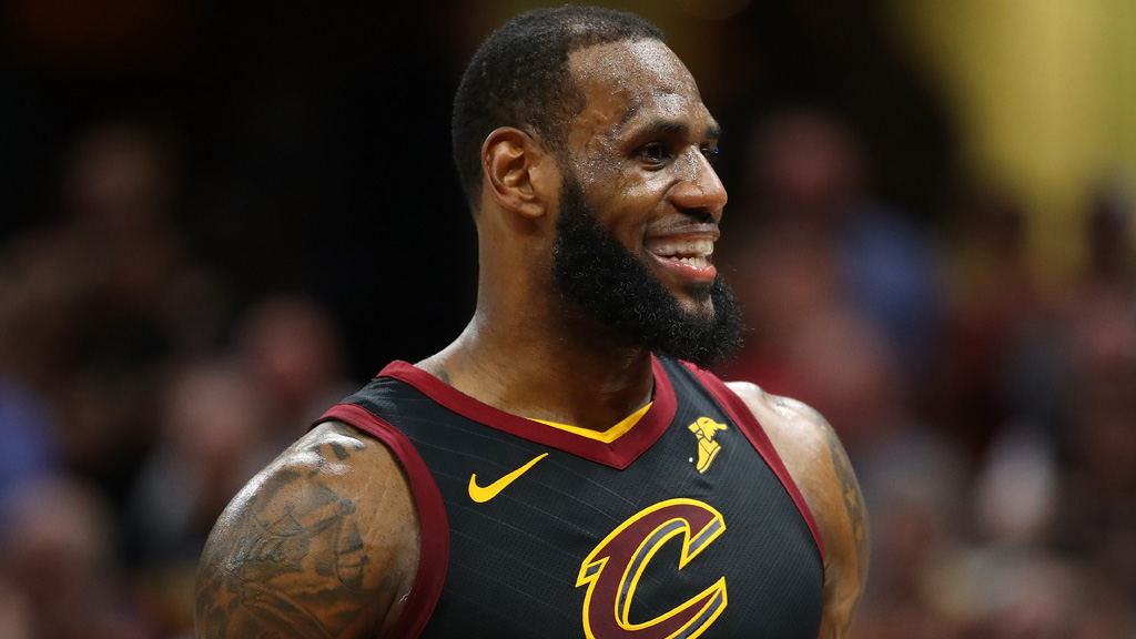 LeBron James #23 of the Cleveland Cavaliers smiles while playing the Toronto Raptors Game Three of the Eastern Conference Semifinals during the 2018 NBA Playoffs at Quicken Loans Arena on May 5, 2018 in Cleveland, Ohio. Cleveland won the game 105-103 to take a 3-0 series lead.
