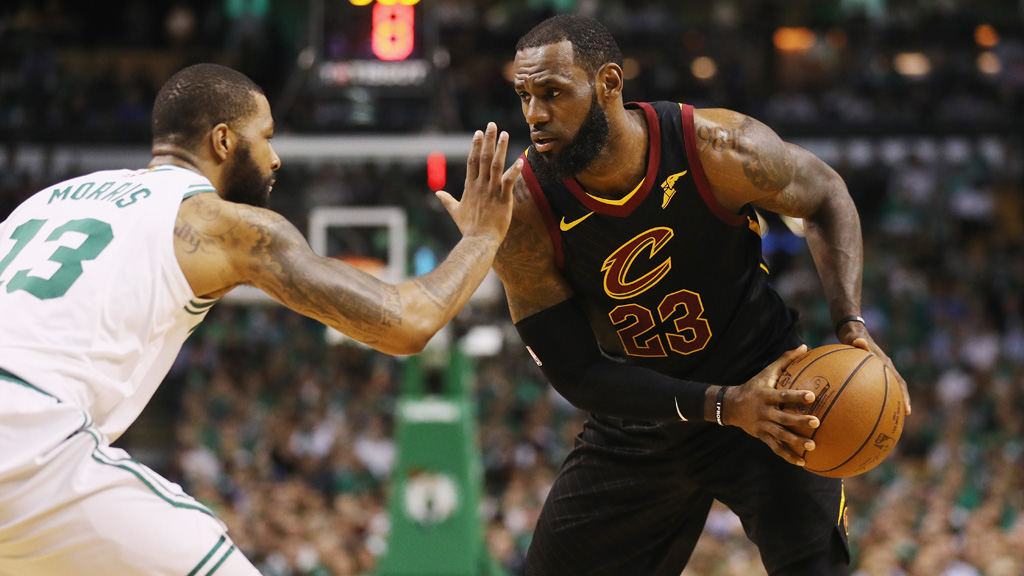 LeBron James #23 of the Cleveland Cavaliers handles the ball against Marcus Morris #13 of the Boston Celtics in the first half during Game Five of the 2018 NBA Eastern Conference Finals at TD Garden on May 23, 2018 in Boston, Massachusetts.