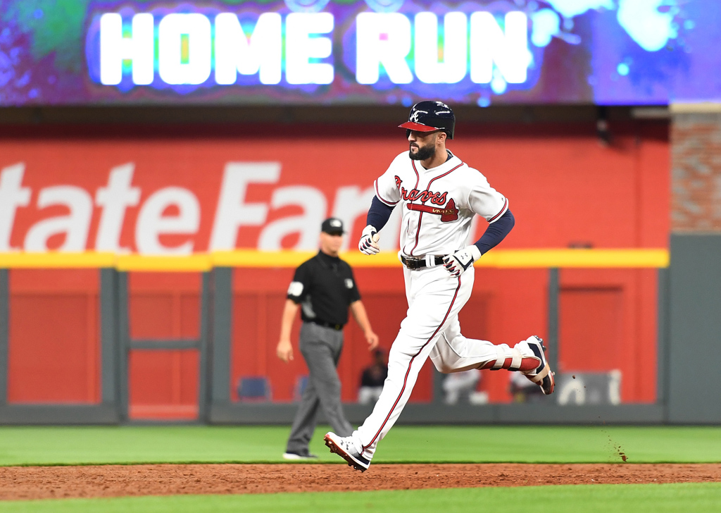 Nick Markakis #22 of the Atlanta Braves rounds the bases after hitting a solo home run in the third inning against the San Francisco Giants at SunTrust Park on May 4, 2018 in Atlanta, Georgia.