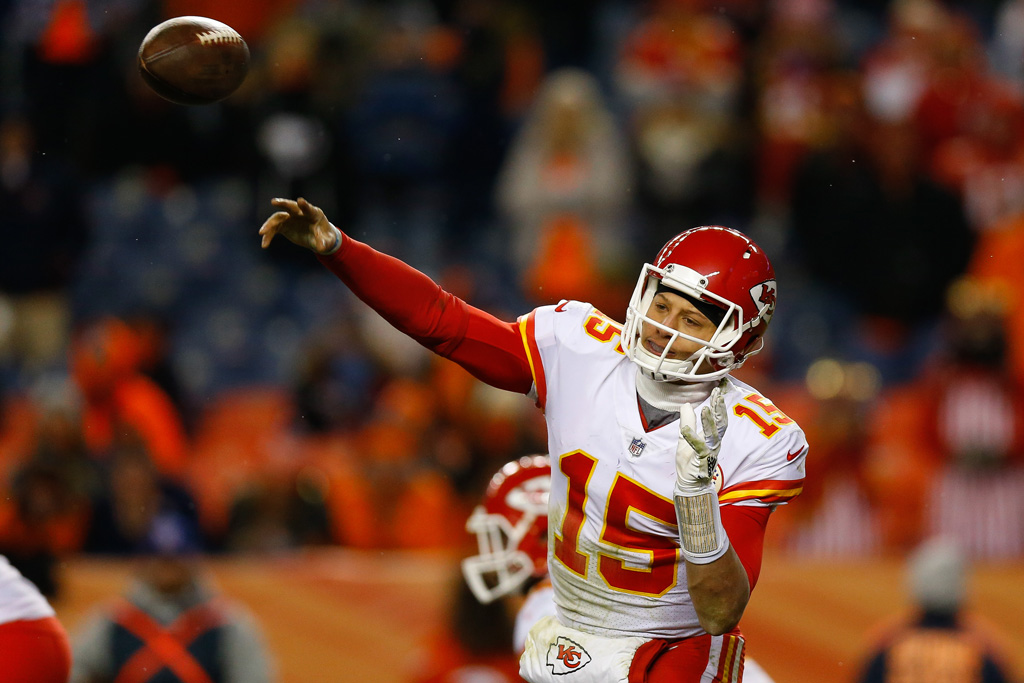 Quarterback Patrick Mahomes #15 of the Kansas City Chiefs throws a pass during the fourth quarter against the Denver Broncos at Sports Authority Field at Mile High on December 31, 2017 in Denver, Colorado. The Chiefs defeated the Broncos 27-24.