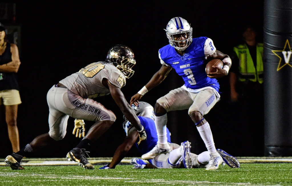 Richie James #3 of the Middle Tennessee State Blue Raiders rushes against Oren Burks #20 of the Vanderbilt Commodores during the second half at Vanderbilt Stadium on September 10, 2016 in Nashville, Tennessee.