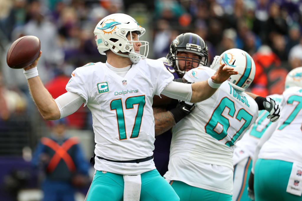 Quarterback Ryan Tannehill #17 of the Miami Dolphins drops back while teammate offensive guard Laremy Tunsil #67 blocks against the Baltimore Ravens in the second quarter at M&T Bank Stadium on December 4, 2016 in Baltimore, Maryland.