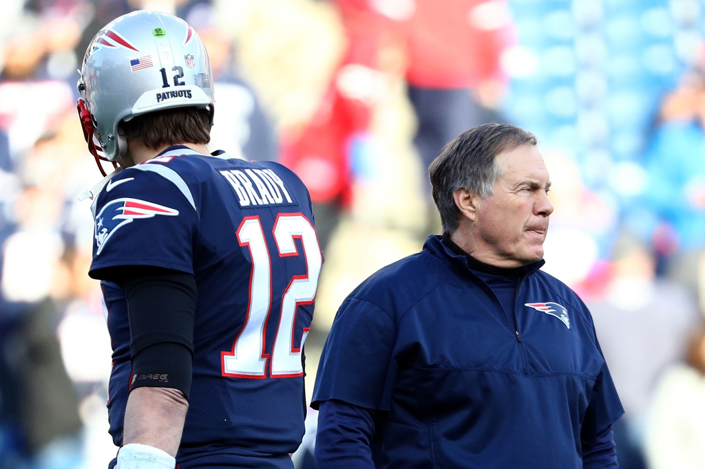 Tom Brady #12 of the New England Patriots and head coach Bill Belichick look on during warm ups before the AFC Championship Game against the Jacksonville Jaguars at Gillette Stadium on January 21, 2018 in Foxborough, Massachusetts.