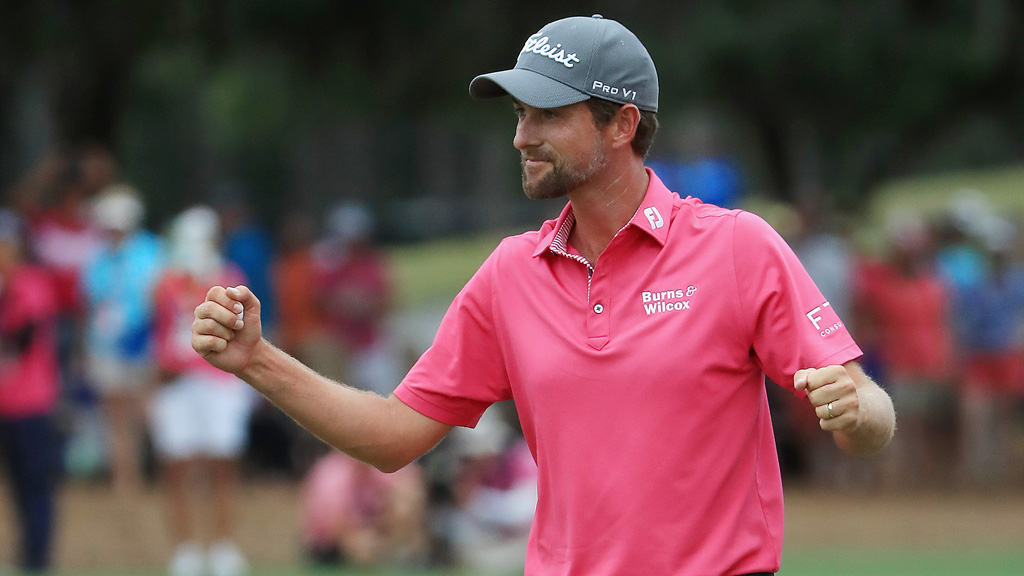 Webb Simpson of the United States celebrates on the 18th green after winning during the final round of THE PLAYERS Championship on the Stadium Course at TPC Sawgrass on May 13, 2018 in Ponte Vedra Beach, Florida.