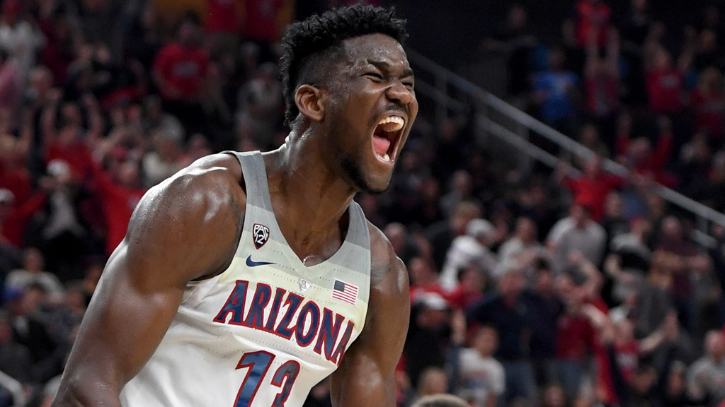 Deandre Ayton #13 of the Arizona Wildcats reacts after dunking against the USC Trojans during the championship game of the Pac-12 basketball tournament at T-Mobile Arena on March 10, 2018 in Las Vegas, Nevada. The Wildcats won 75-61.