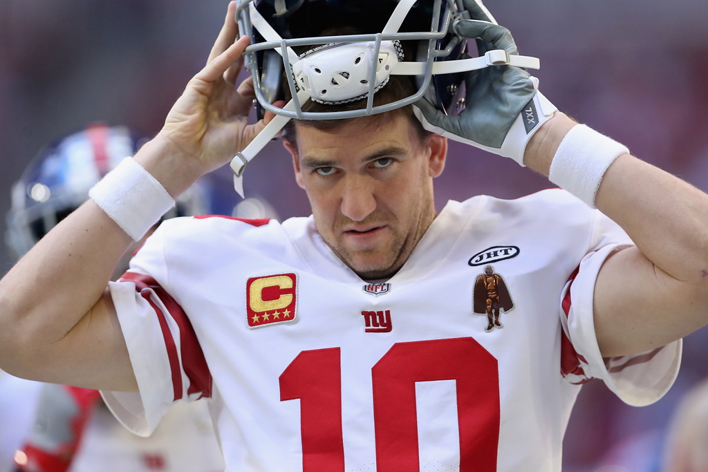 Quarterback Eli Manning #10 of the New York Giants puts on his helmet during the first half of the NFL game against the Arizona Cardinals at the University of Phoenix Stadium on December 24, 2017 in Glendale, Arizona. The Cardinals defeated the Giants 23-0.