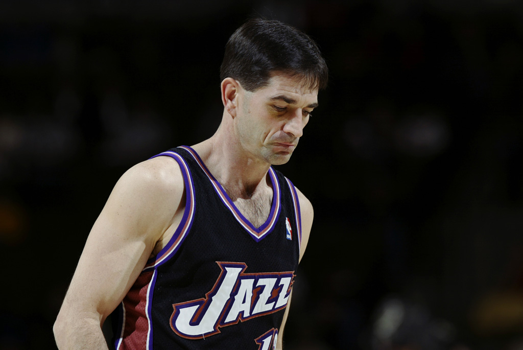 John Stockton #12 of the Utah Jazz looks on against the Denver Nuggets during the game at Pepsi Center on January 15 2003 in Denver, Colorado. The Jazz won 92-81.