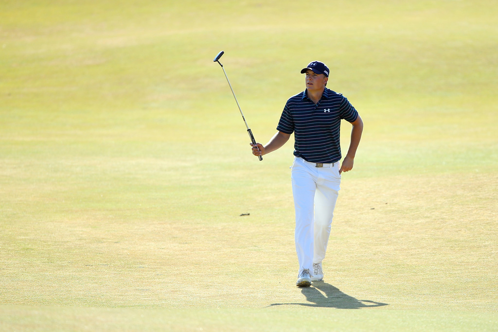Jordan Spieth of the United States waves to the gallery as he walks to the 18th green during the final round of the 115th U.S. Open Championship at Chambers Bay on June 21, 2015 in University Place, Washington.