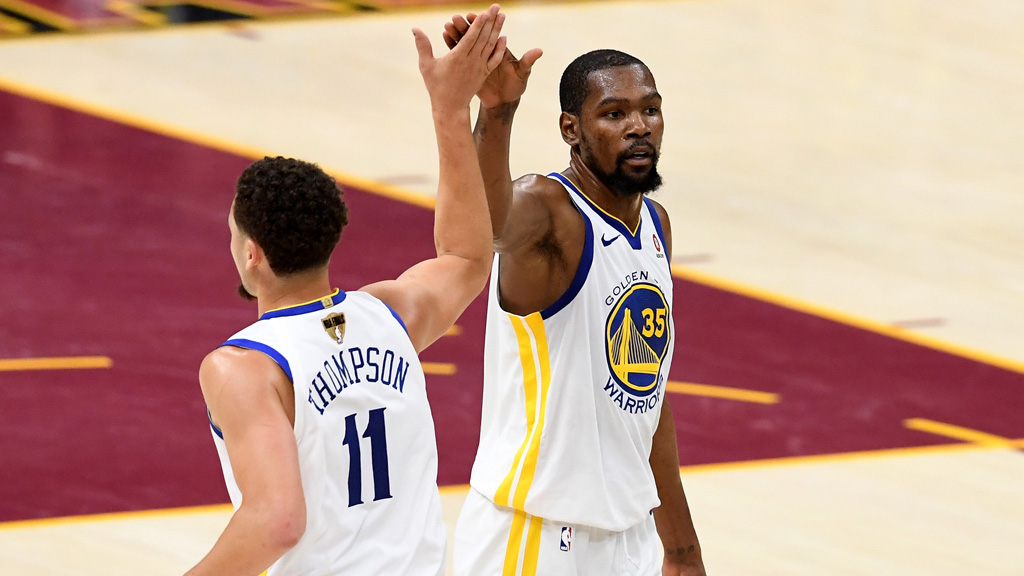Klay Thompson #11 and Kevin Durant #35 of the Golden State Warriors react after a play in the second half against the Cleveland Cavaliers during Game Four of the 2018 NBA Finals at Quicken Loans Arena on June 8, 2018 in Cleveland, Ohio.