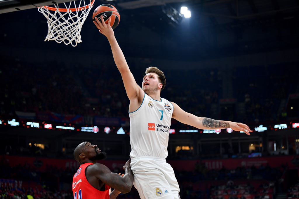 Real Madrid's Slovenian Luka Doncic (R) goes for the basket past CSKA's US center Othello Hunter during the Euroleague Final Four second semifinal match between CSKA Moscow and Real Madrid at Belgrade's Stark Arena on May 18, 2018.