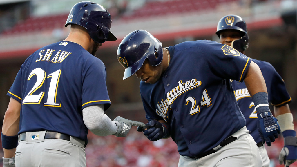 Jesus Aguilar #24 of the Milwaukee Brewers celebrates with Travis Shaw #21 after Aguilar hit a home run in the third inning against the Cincinnati Reds at Great American Ball Park on June 28, 2018 in Cincinnati, Ohio.