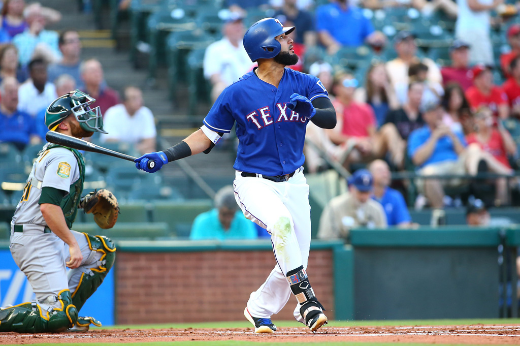 Nomar Mazara #30 of the Texas Rangers hits in the first inning against the Oakland Athletics at Globe Life Park in Arlington on June 5, 2018 in Arlington, Texas.