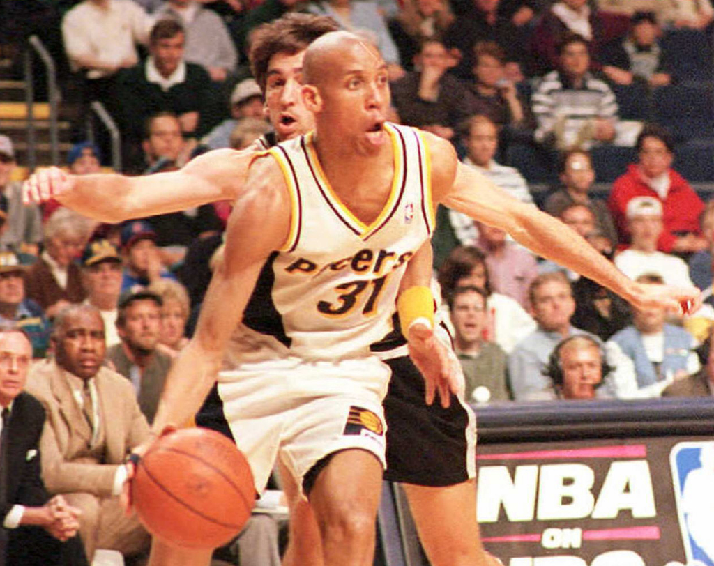 Indiana Pacers guard Reggie Miller (31) drives around San Antonio Spurs guard Vinny Del Negro during first period action in their 24 March game at Market Square Arena in Indianapolis, Indiana. Miller was later ejected from the game with two technical fouls. The Spurs defeated the Pacers 100-88.