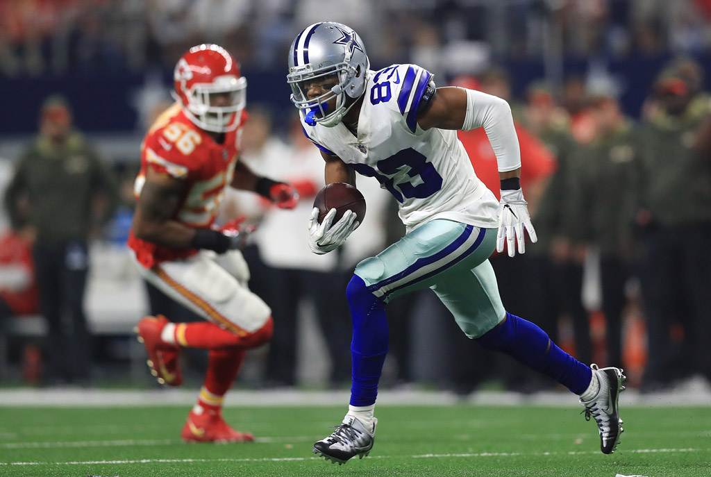 Terrance Williams #83 of the Dallas Cowboys carries the ball in the fourth quarter of a football game against the Kansas City Chiefs at AT&T Stadium on November 5, 2017 in Arlington, Texas.