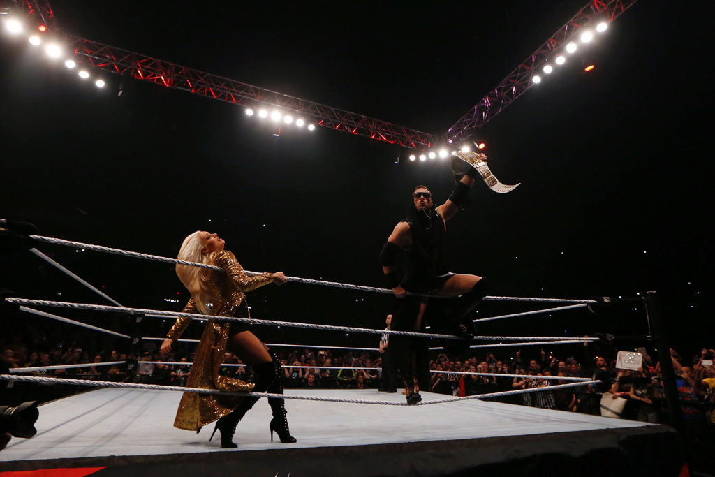 Wrestlers The Miz and Maryse fight during a show at the AccorHotels Arena in Paris, as part of the WrestleMania Revenge Tour, the World Wrestling Entertainment (WWE) European tour, on April 22, 2016.