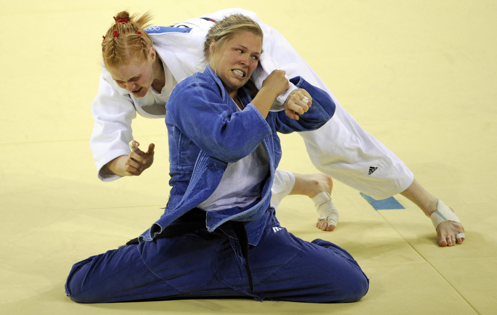 United States Ronda Rousey (blue) and Germany's Annett Boehm compete in their women's -70kg judo bronze medal match of the 2008 Beijing Olympic Games on August 13, 2008 in Beijing. US Ronda Rousey won the bronze medal.