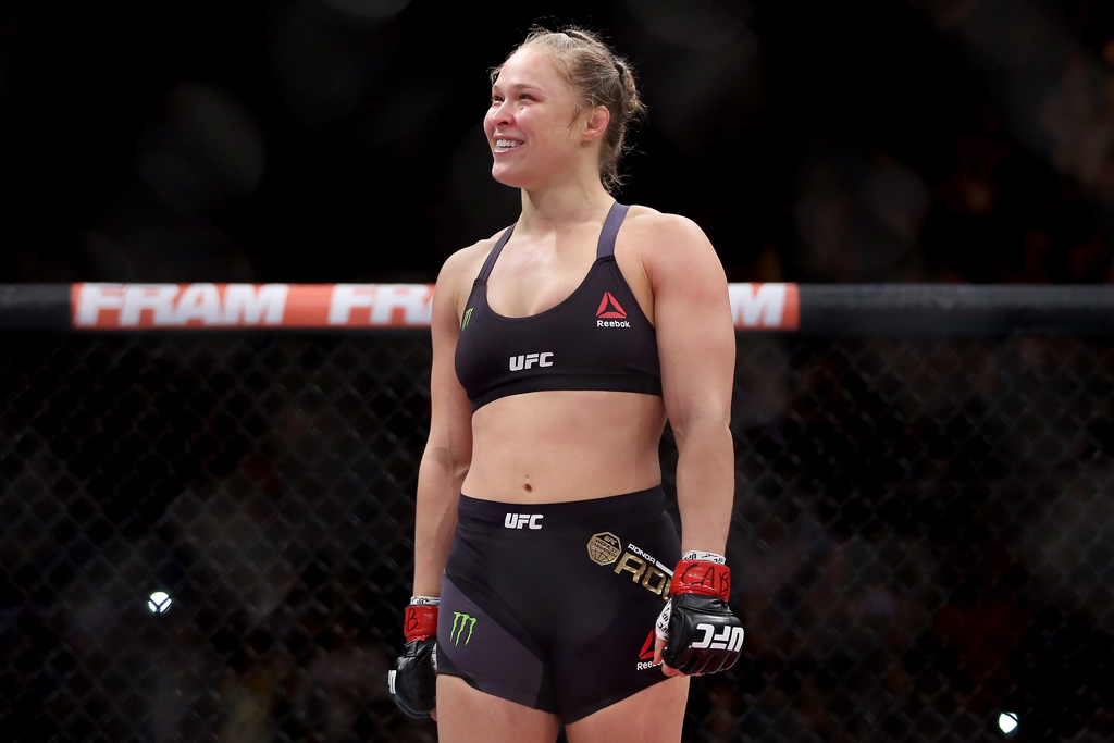 Ronda Rousey of the United States defeats Bethe Correia of Brazil in their bantamweight title fight during the UFC 190 Rousey v Correia at HSBC Arena on August 1, 2015 in Rio de Janeiro, Brazil.