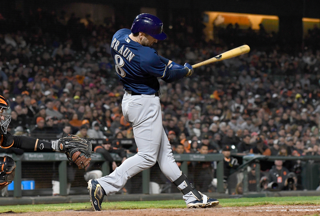 Ryan Braun #8 of the Milwaukee Brewers hits an rbi single scoring Christian Yelich #22 against the San Francisco Giants in the top of the eighth inning at AT&T Park on July 26, 2018 in San Francisco, California.