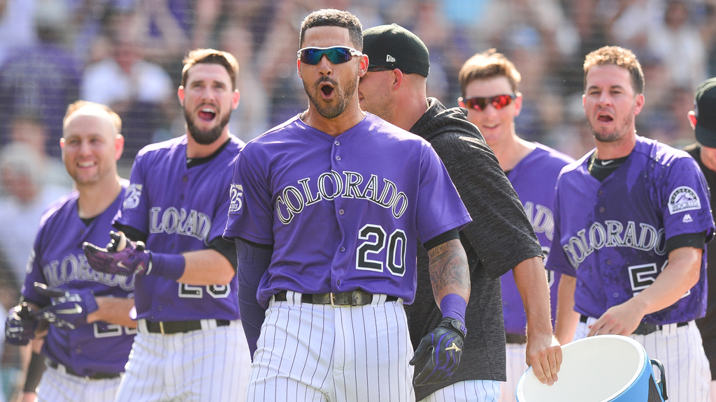 Ian Desmond #20 of the Colorado Rockies celebrates with teammates after hitting a ninth inning 2-run walk off homerun to beat the San Diego Padres 4-3 during a game at Coors Field on August 23, 2018 in Denver, Colorado.