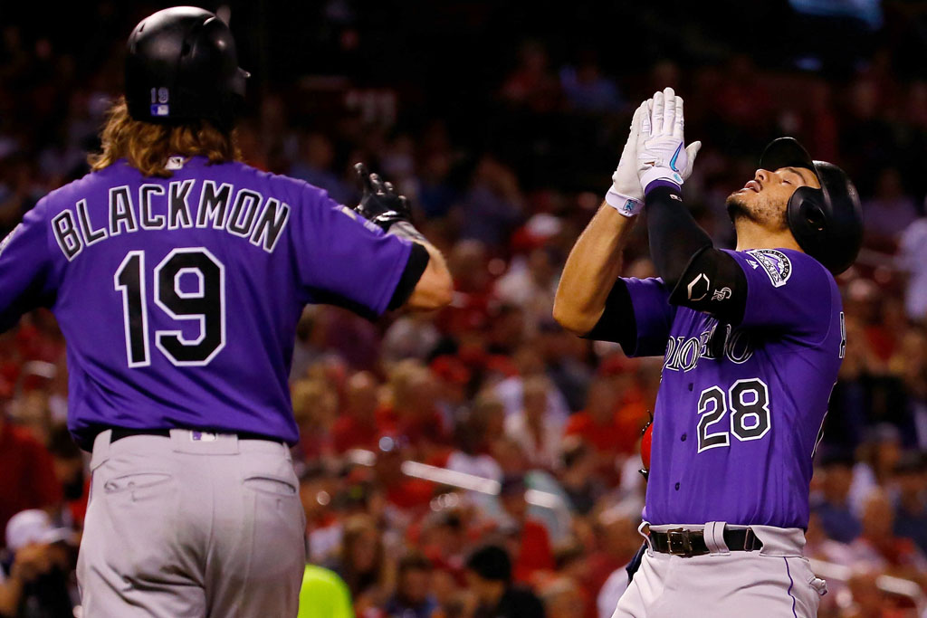 Nolan Arenado #28 of the Colorado Rockies celebrates after hitting a grand slam against the St. Louis Cardinals in the fifth inning at Busch Stadium on July 30, 2018 in St. Louis, Missouri.