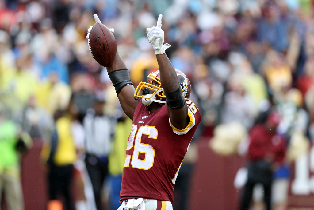 Adrian Peterson #26 of the Washington Redskins celebrates after rushing for a first half touchdown against the Green Bay Packers at FedExField on September 23, 2018 in Landover, Maryland.
