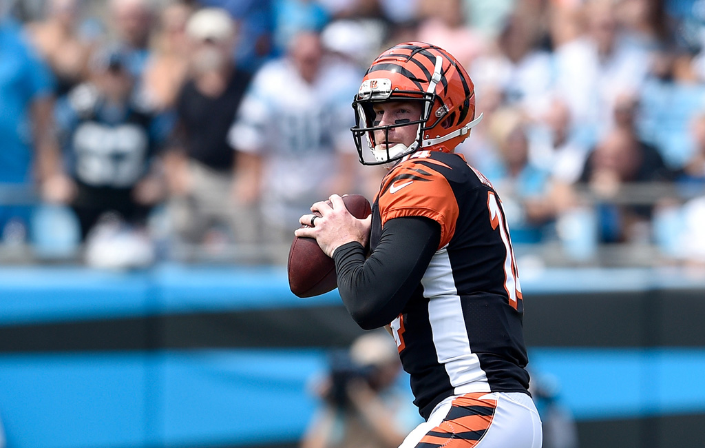 Andy Dalton #14 of the Cincinnati Bengals throws a pass against the Carolina Panthers in the first quarter during their game at Bank of America Stadium on September 23, 2018 in Charlotte, North Carolina.