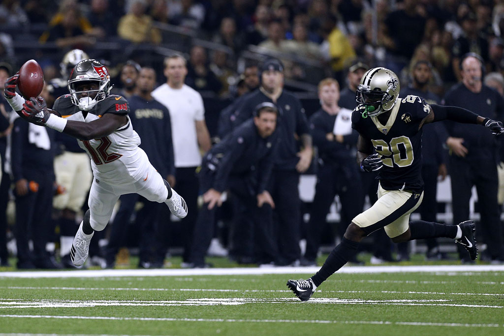 Chris Godwin #12 of the Tampa Bay Buccaneers catches the ball as Ken Crawley #20 of the New Orleans Saints defends during the first half at the Mercedes-Benz Superdome on September 9, 2018 in New Orleans, Louisiana.