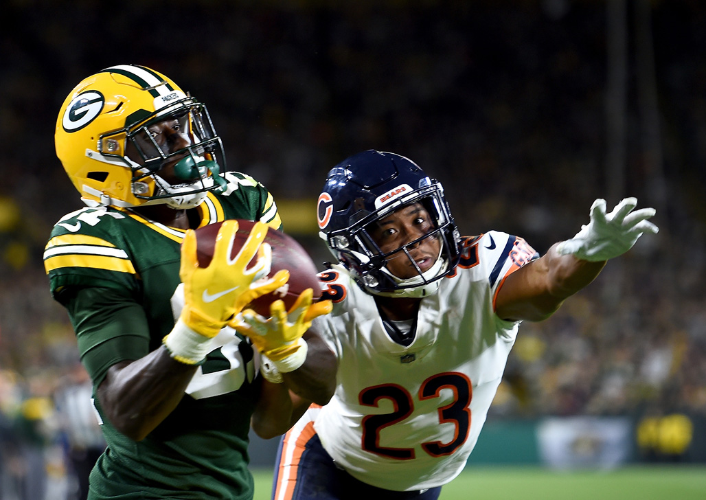 Geronimo Allison #81 of the Green Bay Packers catches a touchdown against Kyle Fuller #23 of the Chicago Bears during the fourth quarter of a game at Lambeau Field on September 9, 2018 in Green Bay, Wisconsin.