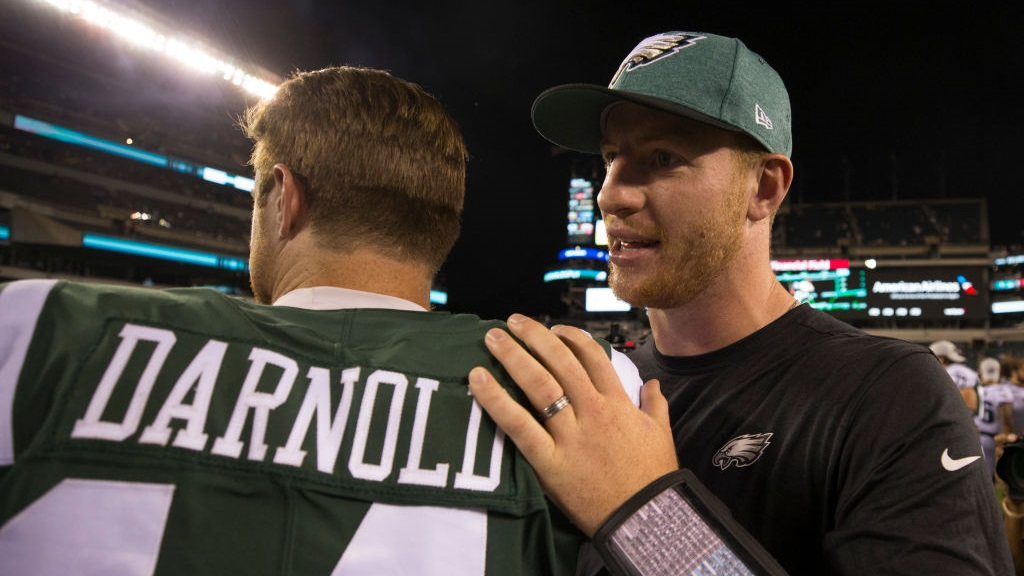 Sam Darnold #14 of the New York Jets talks to Carson Wentz #11 of the Philadelphia Eagles after the preseason game at Lincoln Financial Field on August 30, 2018 in Philadelphia, Pennsylvania.