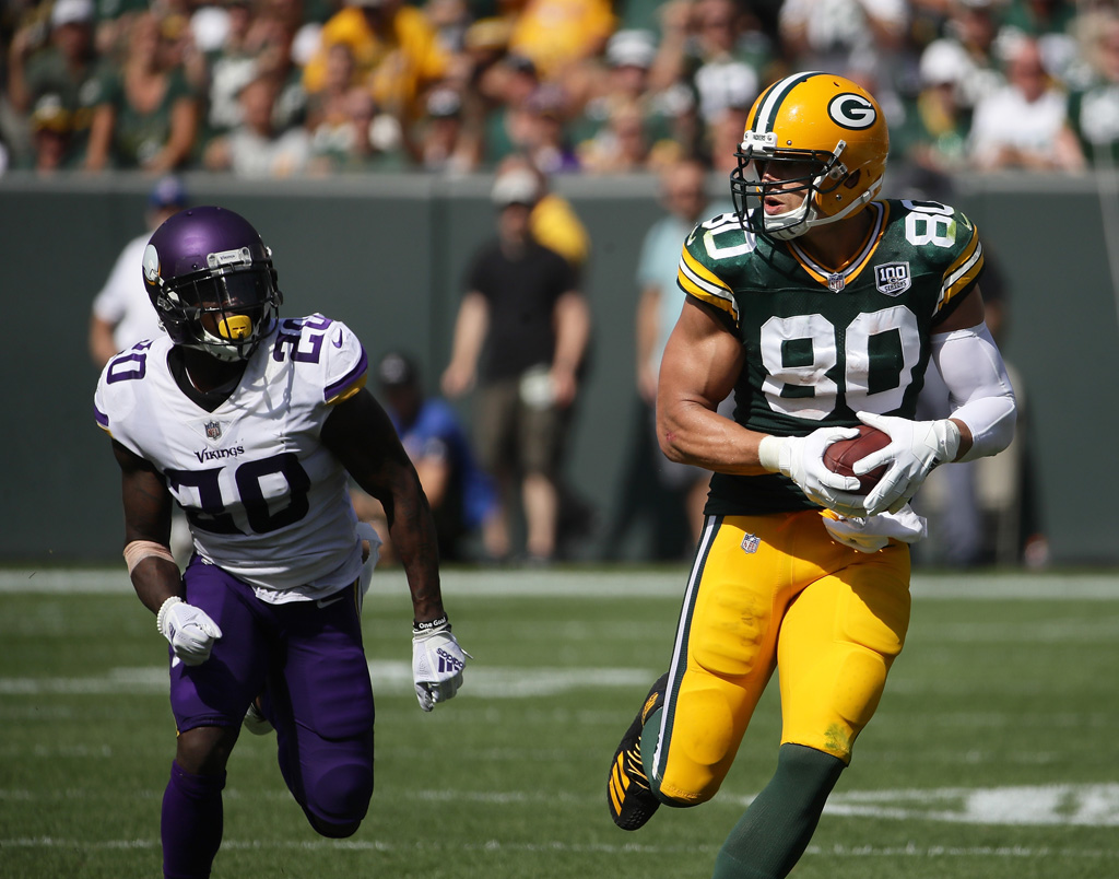 Jimmy Graham #80 of the Green Bay Packers makes a catch in front of Mackensie Alexander #20 of the Minnesota Vikings during the third quarter of a game at Lambeau Field on September 16, 2018 in Green Bay, Wisconsin.