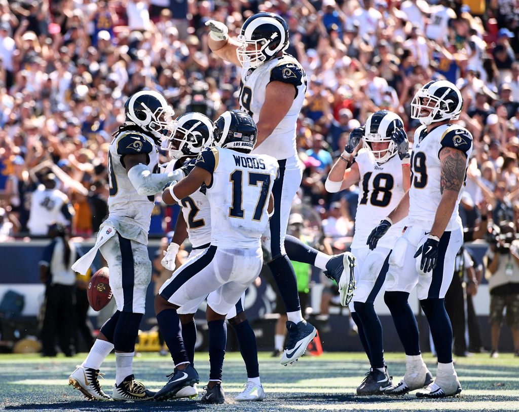 Todd Gurley #30 of the Los Angeles Rams celebrates his touchdown with teammates, to take a 19-0 lead over the Arizona Cardinals, after a two point conversion, during the second quarter at Los Angeles Memorial Coliseum on September 16, 2018 in Los Angeles, California.