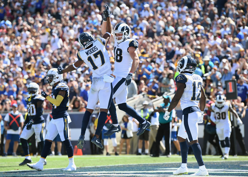 Robert Woods #17 of the Los Angeles Rams celebrates his touchdown catch with teammate Cooper Kupp #18 during the first quarter of the game against the Los Angeles Chargers at Los Angeles Memorial Coliseum on September 23, 2018 in Los Angeles, California.